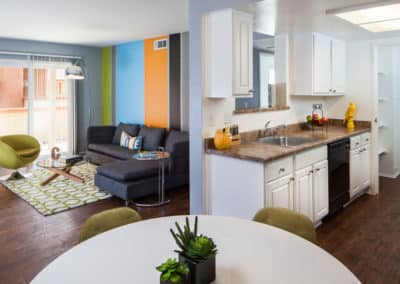 View of living room and kitchen model at Corona Pointe Resort