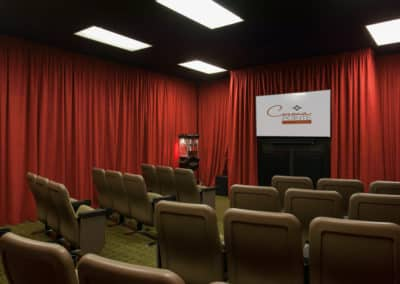 Room with red curtain around and chairs in line